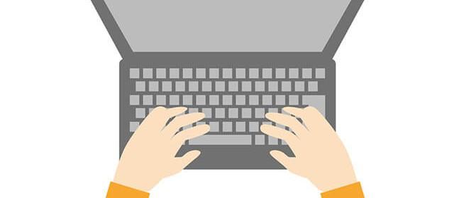 パソコン画面と手